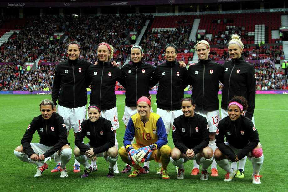 MANCHESTER, ENGLAND - AUGUST 06:  Canada poses before kick off during the Women's Football Semi Final match between Canada and USA, on Day 10 of the London 2012 Olympic Games at Old Trafford on August 6, 2012 in Manchester, England. Photo: Stanley Chou, Getty Images / 2012 Getty Images