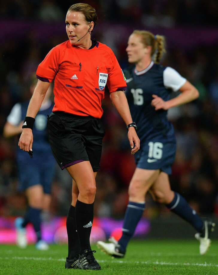 Referee Christina Pedersen of Norway (L) officiates during the London 2012 Olympic Games womens semi-final football match between the US and Canada at Old Trafford in Manchester, north-west England on August 6, 2012. AFP PHOTO / ANDREW YATESANDREW YATES/AFP/GettyImages Photo: ANDREW YATES, AFP/Getty Images / AFP