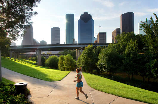 A woman jogs the North Trail of the Buffalo Bayou Walk Tuesday, Aug. 7, 2012, in Houston. Photo: Cody Duty, Houston Chronicle / © 2011 Houston Chronicle