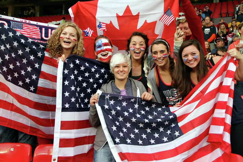 MANCHESTER, ENGLAND - AUGUST 06:  USA fans cheer during the Women's Football Semi Final match between Canada and USA, on Day 10 of the London 2012 Olympic Games at Old Trafford on August 6, 2012 in Manchester, England. Photo: Stanley Chou, Getty Images / 2012 Getty Images