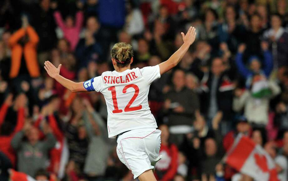 Canada's forward Christine Sinclair celebrates scoring her second goal during the London 2012 Olympic women's football semi final match between the US and Canada at Old Trafford in Manchester, north-west England, on August 6, 2012.  AFP PHOTO/PAUL ELLISPAUL ELLIS/AFP/GettyImages Photo: PAUL ELLIS, AFP/Getty Images / AFP