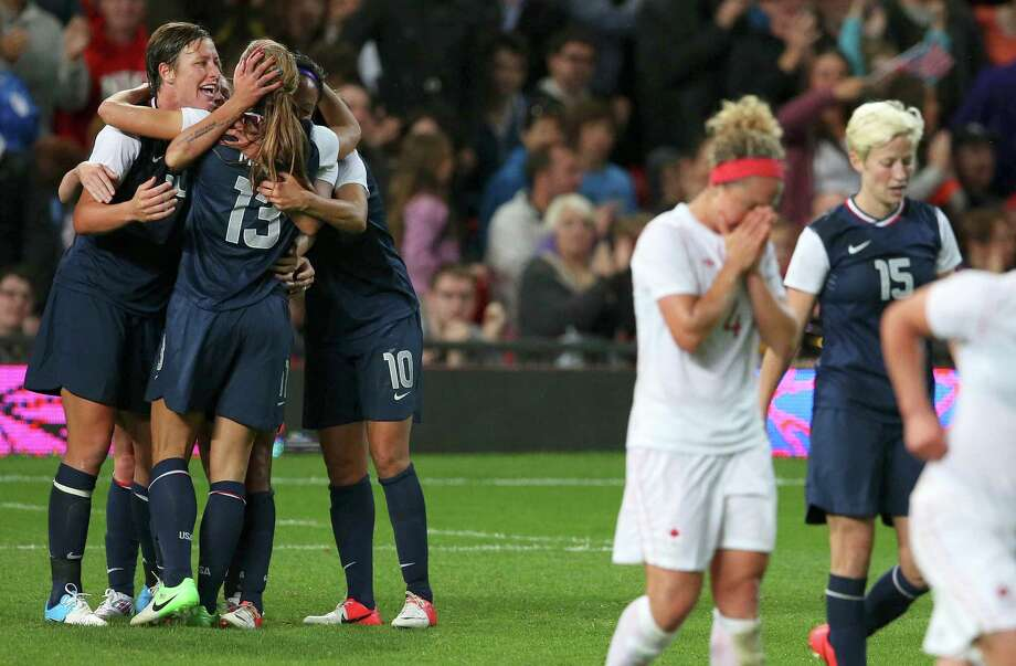 U.S. forward Alex Morgan (13) celebrates with teammates after scoring the game-winning goal against Canada during the women's soccer semifinals at the 2012 Summer Olympic Games in London, Aug. 6, 2012. The U.S. won the match and will advance to the finals against Japan. (Doug Mills/The New York Times) Photo: DOUG MILLS, NYT / NYTNS