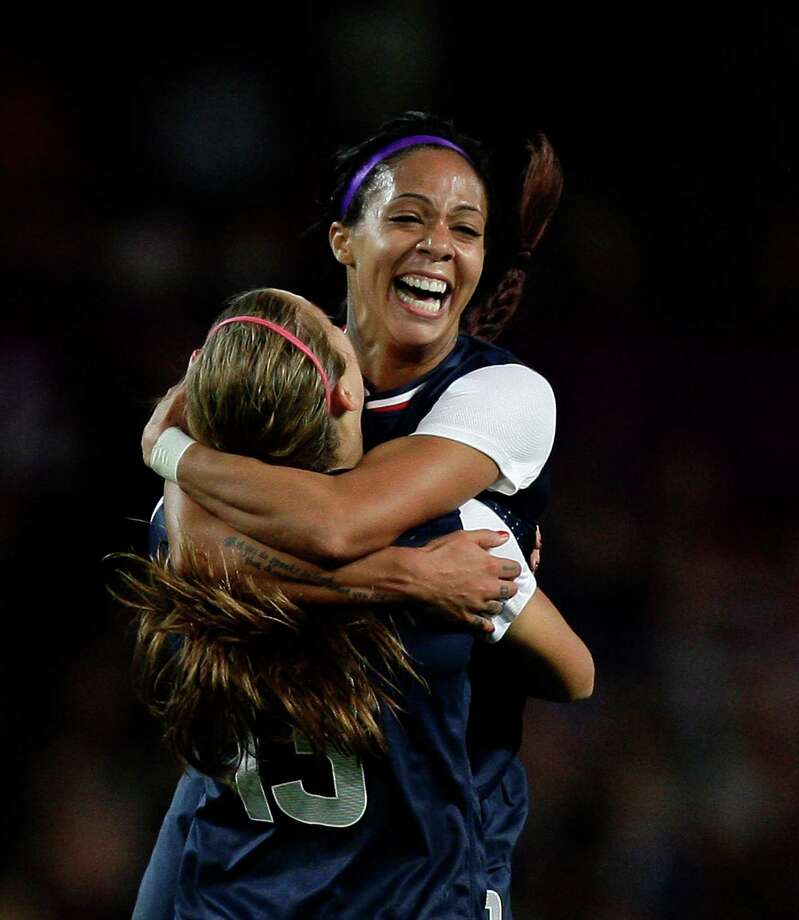 United States' Sydney Leroux, top, celebrates with scorer of the winning goal Alex Morgan following their semifinal win over Canada in a women's soccer match at the 2012 London Summer Olympics, Monday, Aug. 6, 2012 at Old Trafford Stadium in Manchester, England. Photo: Jon Super, AP / AP
