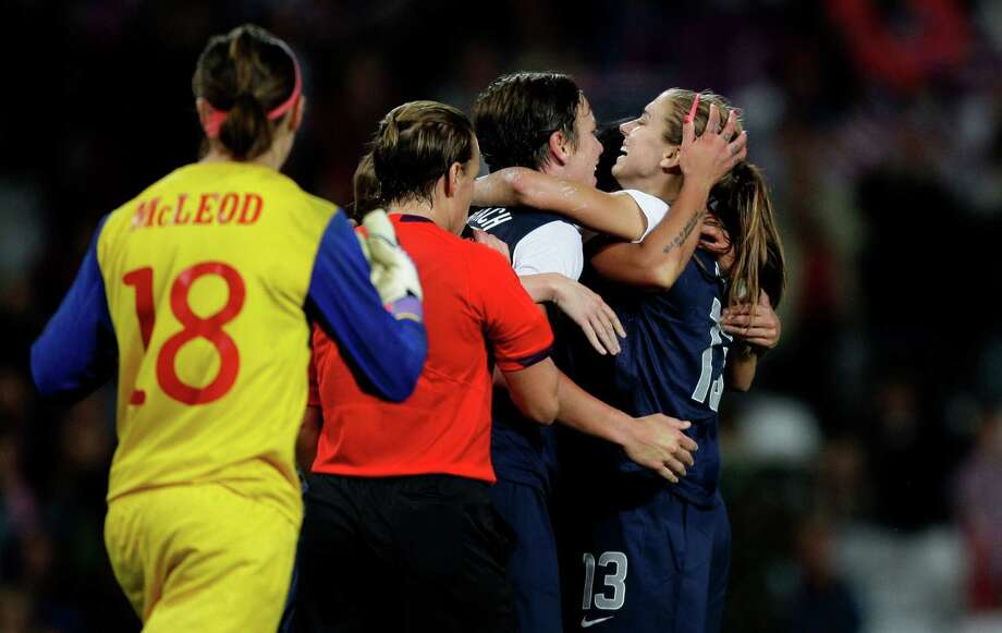 United States' Alex Morgan, right, celebrates with teammates after scoring past Canada's goalkeeper Erin Mcleod, left, during their semifinal women's soccer match at the 2012 London Summer Olympics, Monday, Aug. 6, 2012, at Old Trafford Stadium in Manchester, England. Photo: Jon Super, AP / AP