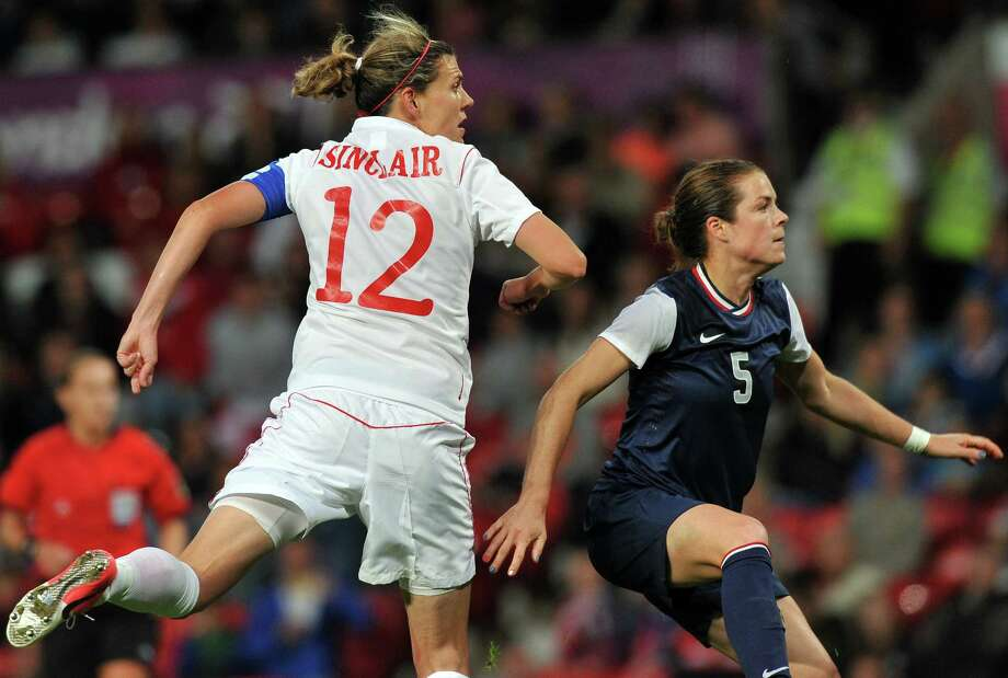 Canada's forward Christine Sinclair (L) scoring her second goal during the London 2012 Olympic women's football semi final match between the US and Canada at Old Trafford in Manchester, north-west England, on August 6, 2012.     AFP PHOTO/PAUL ELLISPAUL ELLIS/AFP/GettyImages Photo: PAUL ELLIS, AFP/Getty Images / AFP