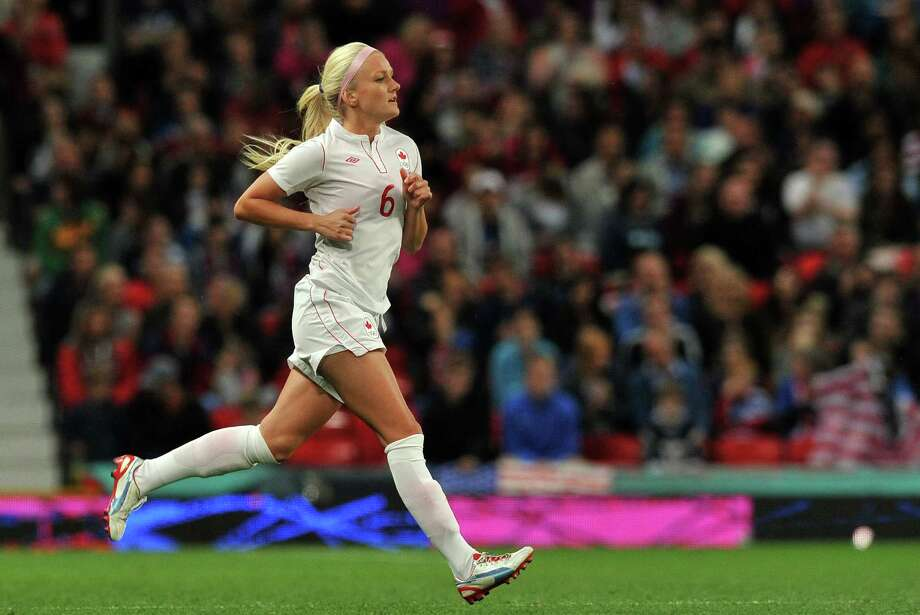 Canada's midfielder Kaylyn Kyle enters as a substitute during the London 2012 Olympic women's football semi final match between the US and Canada at Old Trafford in Manchester, north-west England, on August 6, 2012.  AFP PHOTO/PAUL ELLISPAUL ELLIS/AFP/GettyImages Photo: PAUL ELLIS, AFP/Getty Images / AFP