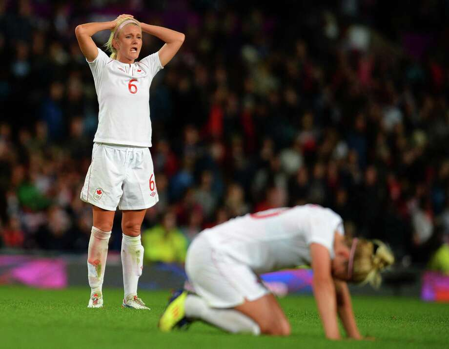 Canada's midfielder Kaylyn Kyle (L) reacts at the final whistle after losing 4-3 during the London 2012 Olympic Games womens semi-final football match between USA and Canada at Old Trafford in Manchester, north-west England on August 6, 2012. AFP PHOTO / ANDREW YATESANDREW YATES/AFP/GettyImages Photo: ANDREW YATES, AFP/Getty Images / AFP