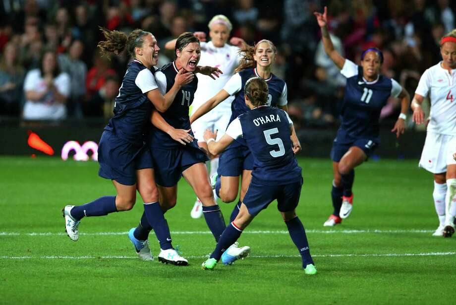 U.S. forward Abby Wambach (14) celebrates with teammates after scoring a goal against Canada during the women's soccer semifinals at the 2012 Summer Olympic Games in London, Aug. 6, 2012. The U.S. won the match and will advance to the finals against Japan. (Doug Mills/ The New York Times) Photo: DOUG MILLS, NYT / NYTNS