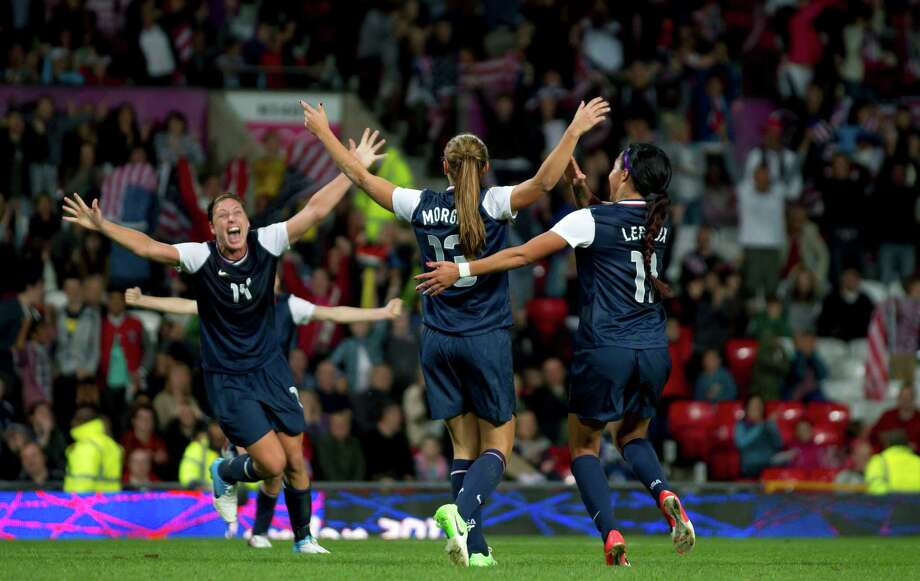 United States' Alex Morgan, center, celebrates with teammates including Abby Wambach, left, and Sydney Leroux after the winning goal was scored past Canada's goalkeeper Erin Mcleod during their semifinal women's soccer match at the 2012 London Summer Olympics, Monday, Aug. 6, 2012, at Old Trafford Stadium in Manchester, England. Photo: Jon Super, AP / AP