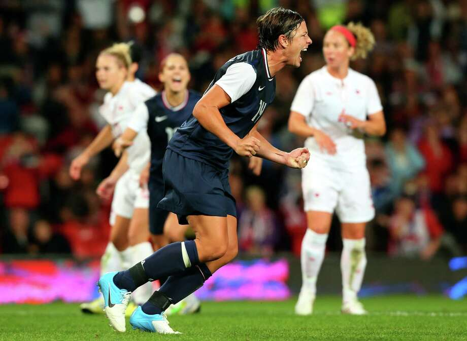MANCHESTER, ENGLAND - AUGUST 06:  Abby Wambach of the United States celebrate after she converted the penalty during the Women's Football Semi Final match between Canada and USA, on Day 10 of the London 2012 Olympic Games at Old Trafford on August 6, 2012 in Manchester, England. Photo: Stanley Chou, Getty Images / 2012 Getty Images