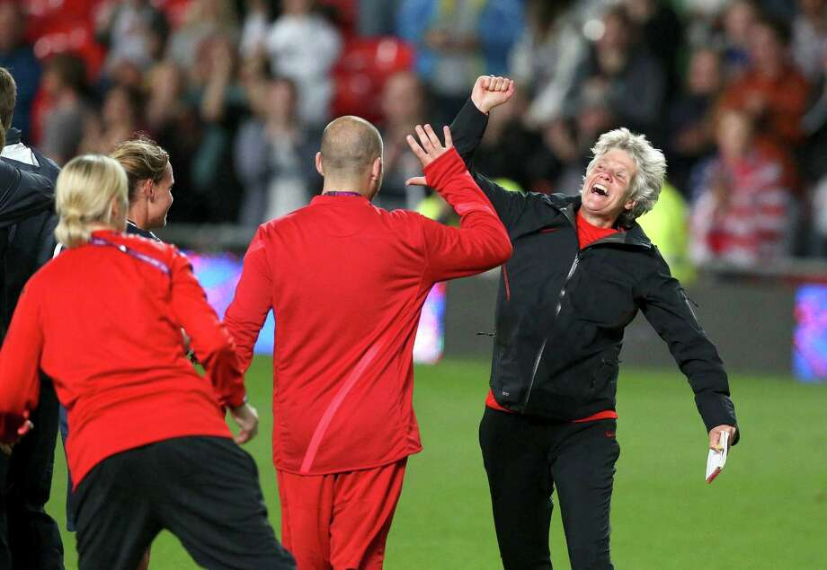 U.S. coach Pia Sundhage celebrates after her team beat Canada during the women's soccer semifinals at the 2012 Summer Olympic Games in London, Aug. 6, 2012. The U.S. will advance to the finals against Japan. (Doug Mills/The New York Times) Photo: DOUG MILLS, NYT / NYTNS