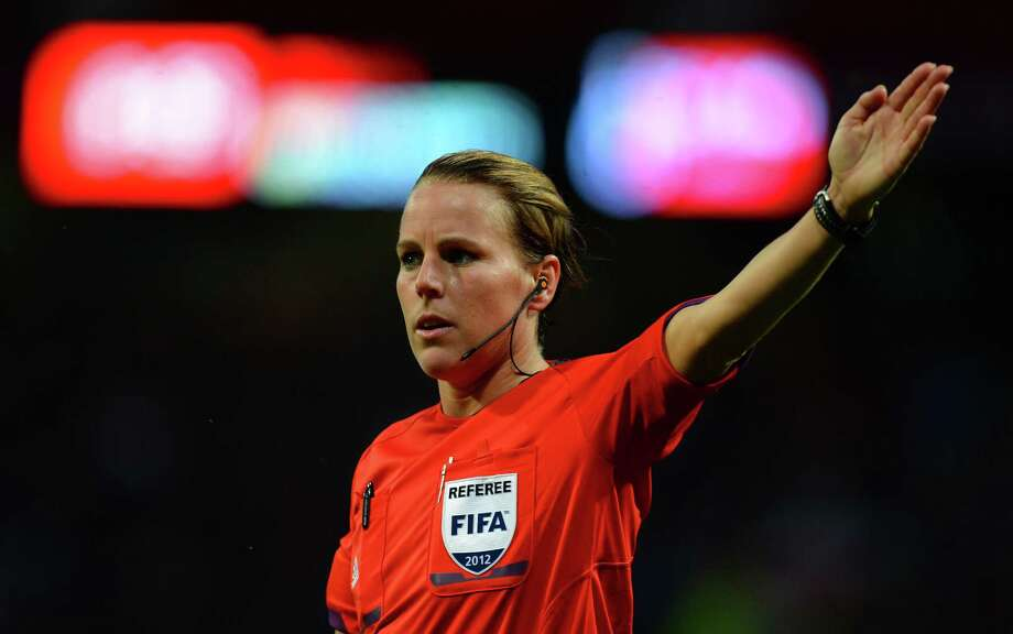 Referee Christina Pedersen of Norway (L) officiates during the London 2012 Olympic Games women's semi-final football match between the US and Canada at Old Trafford in Manchester, north-west England on August 6, 2012. AFP PHOTO / ANDREW YATESANDREW YATES/AFP/GettyImages Photo: ANDREW YATES, AFP/Getty Images / AFP