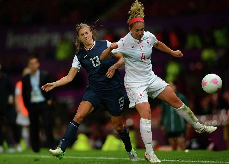 US forward Alex Morgan (L) vies for the ball with Canada's defender Carmelina Moscato during the London 2012 Olympic Games womens semi-final football match between the US and Canada at Old Trafford in Manchester, north-west England on August 6, 2012. AFP PHOTO / ANDREW YATESANDREW YATES/AFP/GettyImages Photo: ANDREW YATES, AFP/Getty Images / AFP