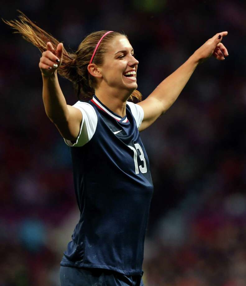 MANCHESTER, ENGLAND - AUGUST 06:  Alex Morgan of of the United States celebrates after scoring during the Women's Football Semi Final match between Canada and USA, on Day 10 of the London 2012 Olympic Games at Old Trafford on August 6, 2012 in Manchester, England. Photo: Stanley Chou, Getty Images / 2012 Getty Images