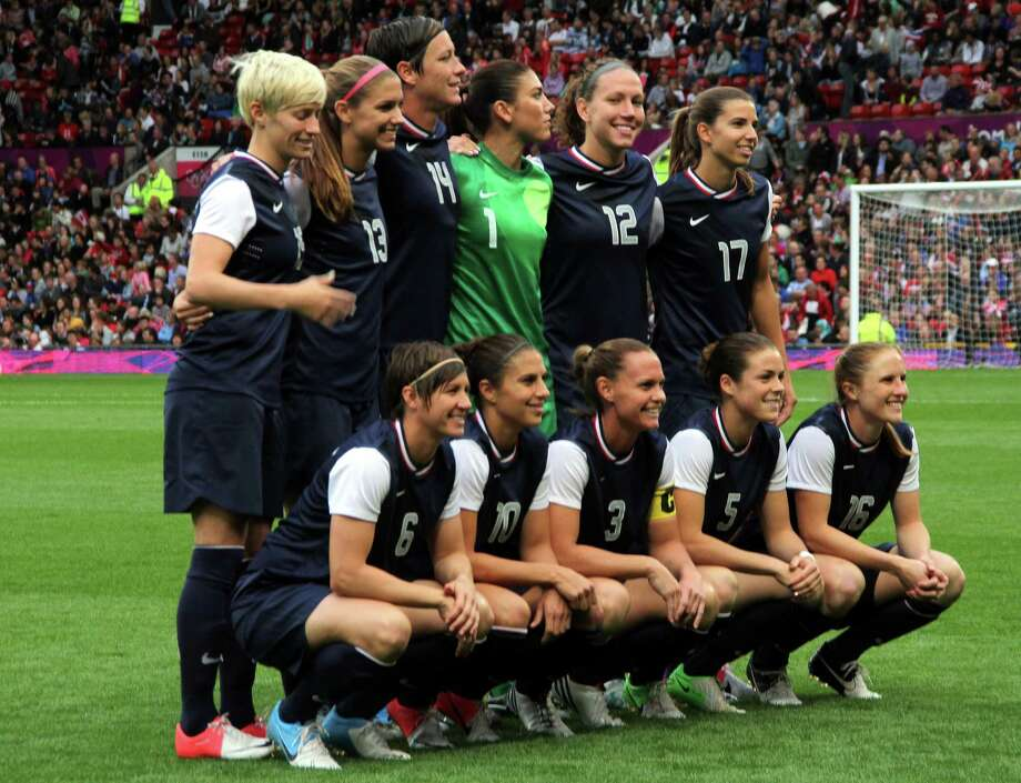 MANCHESTER, ENGLAND - AUGUST 06:  A USA poses before kick off during the Women's Football Semi Final match between Canada and USA, on Day 10 of the London 2012 Olympic Games at Old Trafford on August 6, 2012 in Manchester, England. Photo: Stanley Chou, Getty Images / 2012 Getty Images