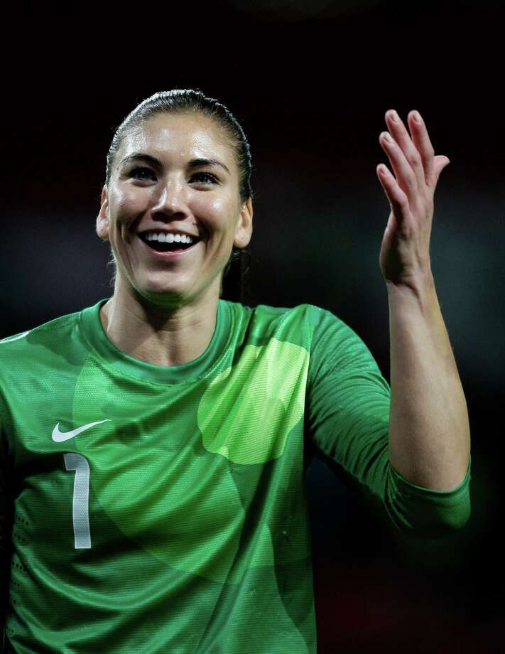 United States goalkeeper Hope Solo reacts after her team's semfinal 4-3 win over Canada in the women's soccer match at the 2012 London Summer Olympics, Monday, Aug. 6, 2012 at Old Trafford Stadium in Manchester, England. Photo: Jon Super, AP / AP