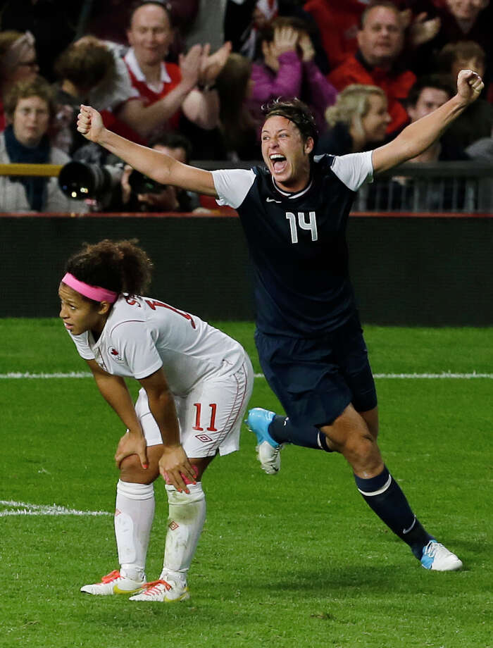 United States' Abby Wambach, right, celebrates her team's final goal,while Canada's Desiree Scott, left, stands dejected in the semifinal women's soccer match between the USA and Canada in the 2012 Summer Olympics, Monday, Aug. 6, 2012, at Old Trafford in Manchester, England. Photo: Ben Curtis, AP / AP