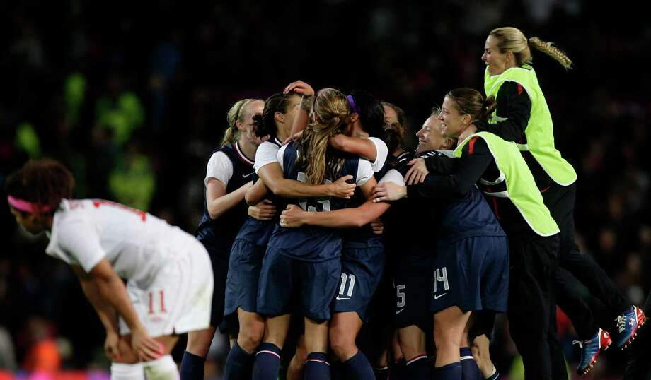 The United States women's soccer team celebrates after their semifinal win over Canada in their women's soccer match at the 2012 London Summer Olympics, Monday, Aug. 6, 2012 at Old Trafford Stadium in Manchester, England. Photo: Jon Super, AP / AP