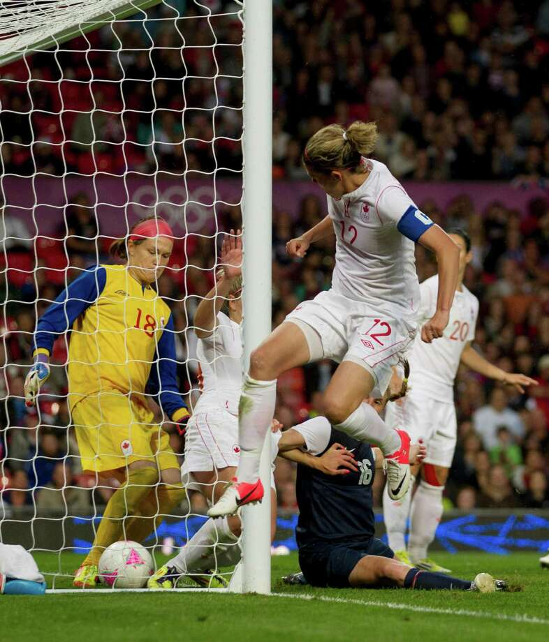Canada's goalkeeper Erin Mcleod, left, and captain Christine Sinclair, upper right, fail to stop a goal from a corner by United States' Megan Rapinoe during their semifinal women's soccer match at the 2012 London Summer Olympics, Monday, Aug. 6, 2012, at Old Trafford Stadium in Manchester, England. Photo: Jon Super, AP / AP