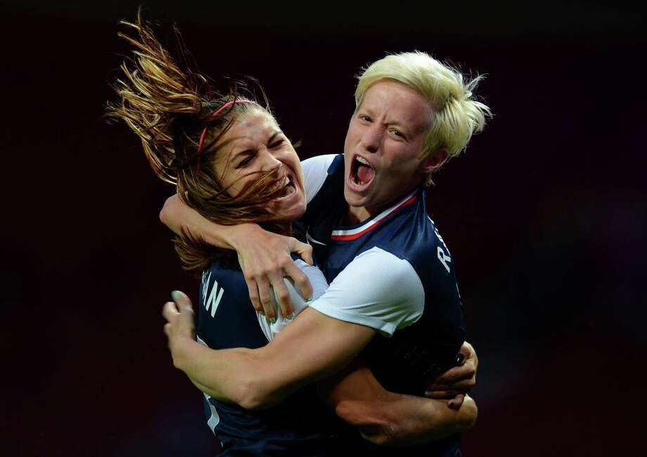 United States's midfielder Megan Rapinoe (R) celebrates with United States's forward Alex Morgan after scoring during the London 2012 Olympic Games womens semi final football match between USA and Canada at Old Trafford in Manchester, north-west England on August 6, 2012. AFP PHOTO / ANDREW YATESANDREW YATES/AFP/GettyImages Photo: ANDREW YATES, AFP/Getty Images / AFP