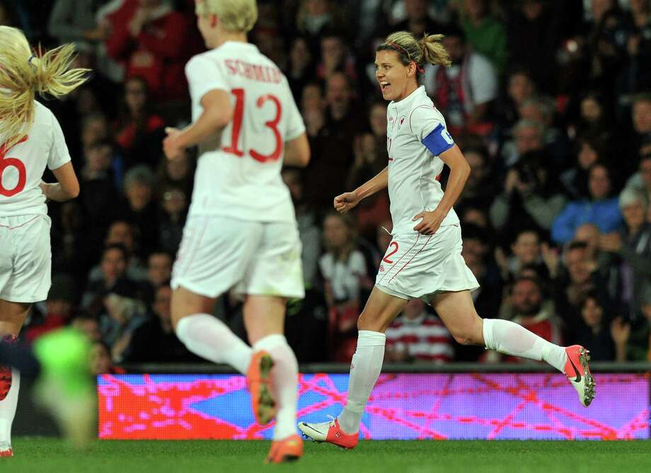 Canada's forward Christine Sinclair (R) celebrates scoring her second goal during the London 2012 Olympic women's football semi final match between USA and Canada at Old Trafford in Manchester, north-west England, on August 6, 2012.  AFP PHOTO/PAUL ELLISPAUL ELLIS/AFP/GettyImages Photo: PAUL ELLIS, AFP/Getty Images / AFP