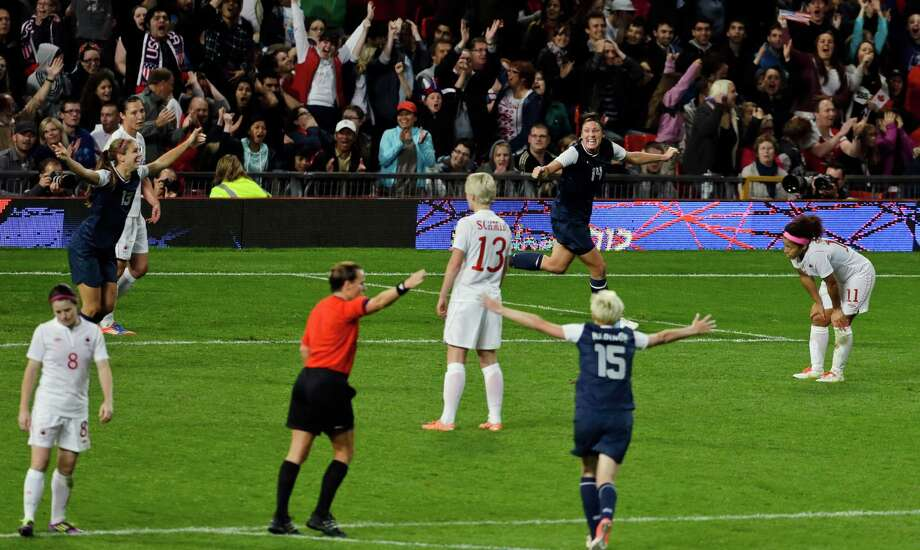 The United States' Alex Morgan, far left, celebrates her goal in the final minutes of extra time with the United States' Abby Wambach, above-right in the semifinal women's soccer match between the USA and Canada in the 2012 Summer Olympics, Monday, Aug. 6, 2012, at Old Trafford in Manchester, England. Photo: Ben Curtis, AP / AP