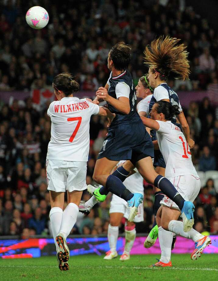 United States forward Alex Morgan (2R) heads the winning goal during the London 2012 Olympic Games womens semi final football match between USA and Canada at Old Trafford in Manchester, north-west England on August 6, 2012. AFP PHOTO / ANDREW YATESANDREW YATES/AFP/GettyImages Photo: ANDREW YATES, AFP/Getty Images / AFP