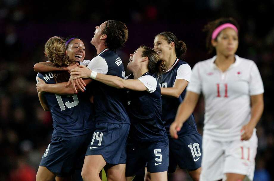 United States' Abby Wambach, center left, celebrates with teammates including her teammate Kelley O Hara, center right, and scorer of the winning goal Alex Morgan, left, after their semifinal win over Canada in their women's soccer match at the 2012 London Summer Olympics, Monday, Aug. 6, 2012 at Old Trafford Stadium in Manchester, England. Photo: Jon Super, AP / AP