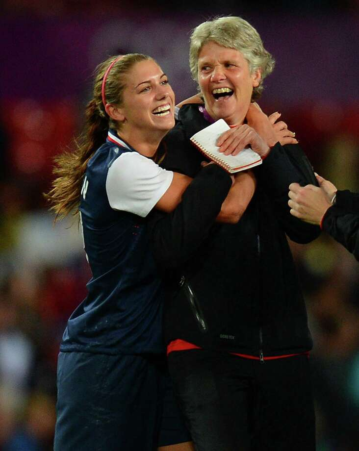US forward Alex Morgan (L) celebrates with  coach  Pia Sundhage after the London 2012 Olympic Games womens semi final football match between USA and Canada at Old Trafford in Manchester, north-west England on August 6, 2012. AFP PHOTO / ANDREW YATESANDREW YATES/AFP/GettyImages Photo: ANDREW YATES, AFP/Getty Images / AFP