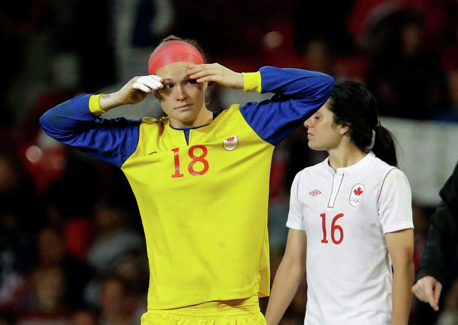 Canada's goalkeeper Erin Mcleod, left, reacts after her team lost the semifinal women's soccer match to the United States at the 2012 London Summer Olympics, in Manchester, England, Monday, Aug. 6, 2012. Photo: Hussein Malla, AP / AP