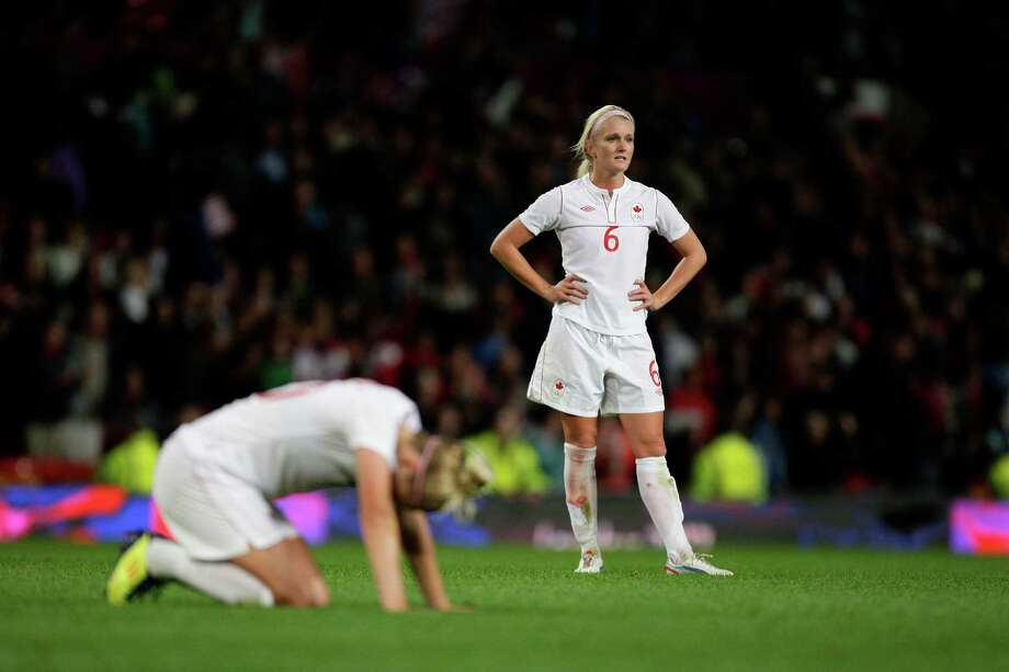 Canada's Kaylyn Kyle, right, reacts after her team's 4-3 loss to the United States in their semifinal women's soccer match at the 2012 London Summer Olympics, Monday, Aug. 6, 2012 at Old Trafford Stadium in Manchester, England. Photo: Jon Super, AP / AP