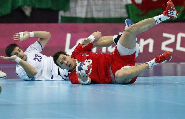 Handball has its fair share of falls.  (AP)