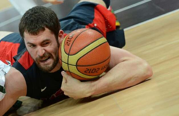 Kevin Love from Team USA makes a fall to save the basketball.  (Getty)