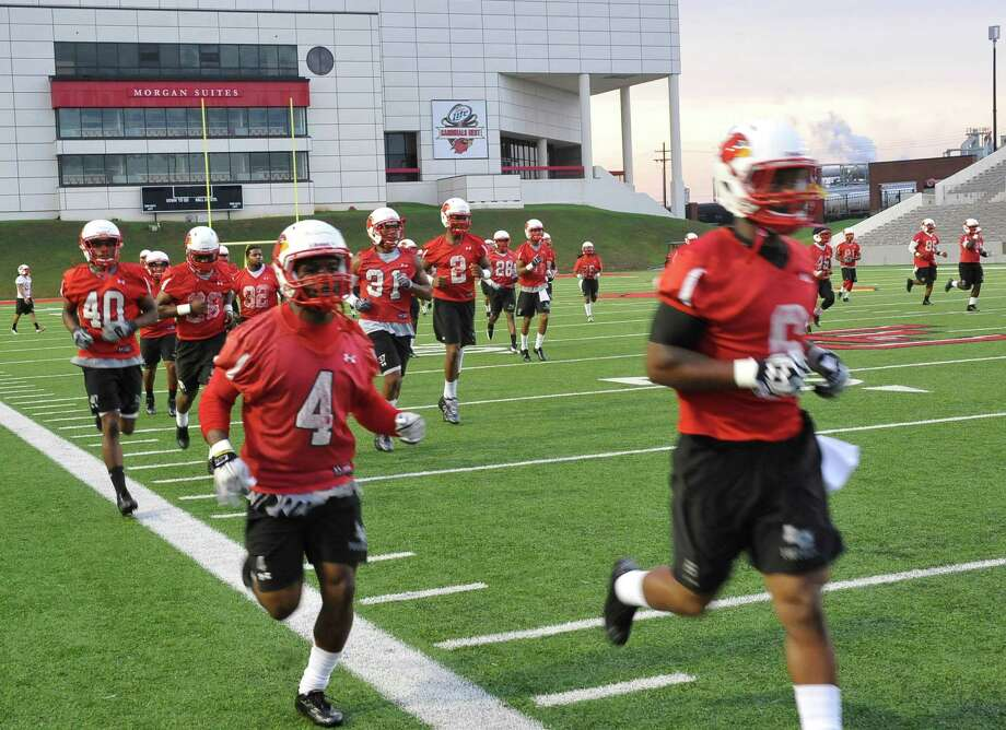The defense gets in running time during practice. The Lamar University football team opened their practice Monday night, August 6, 2012 after the announcement that lightning was out of the area for the 2012 season.  LU will play their season opener on September 1, at Louisiana-Lafayette.   Dave Ryan/The Enterprise Photo: Dave Ryan