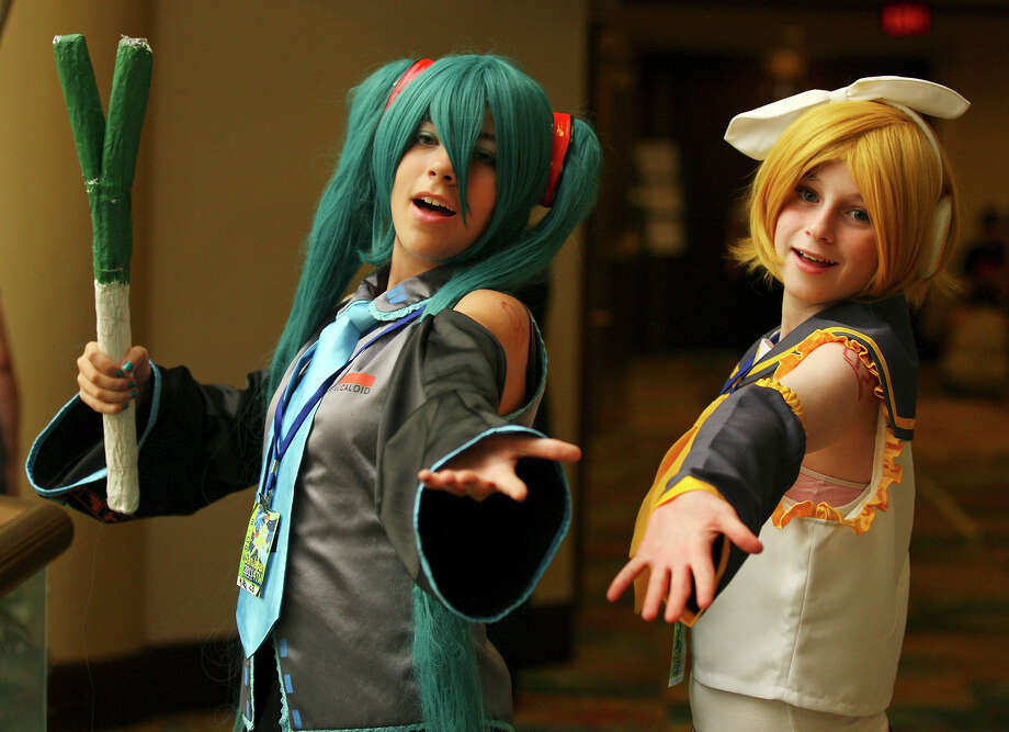 "Addy Stevens, 13, as ""Hatsune Miku"" (left) and Annie Garland, 13 as ""Kagamine Rin"" pose for a photo while attending the San Japan 4TW convention Saturday Aug. 6, 2011 at the Marriott Rivercenter. San Japan 4TW runs Aug. 5-Aug. 7th. (PHOTO BY EDWARD A. ORNELAS/eaornelas@express-news.net) Photo: EDWARD A. ORNELAS, SAN ANTONIO EXPRESS-NEWS / � SAN ANTONIO EXPRESS-NEWS (NFS)"