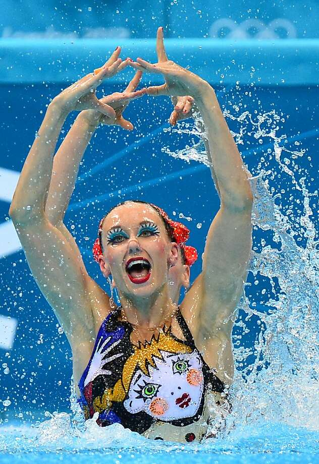 TOPSHOTS Russia's Svetlana Romashina and Russia's Natalia Ishchenko  compete in the duets free routine preliminary round during the synchronised swimming competition at the London 2012 Olympic Games on August 6, 2012 in London.     AFP PHOTO / FABRICE COFFRINIFABRICE COFFRINI/AFP/GettyImages Photo: Fabrice Coffrini, AFP/Getty Images