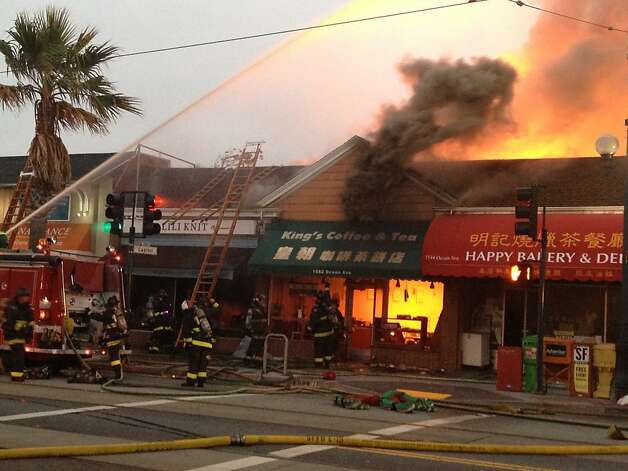 A four-alarm fire burns on Ocean Ave. between Capitol and Miramar Aves. in San Francisco, Calif., on Tuesday, Aug. 7, 2012. Photo: Veronica Weber