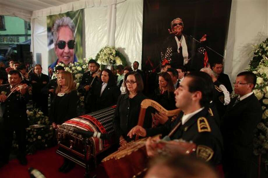 Mariachi musicians perform as city officials stand at honor guard next to the coffin of famed Mexican singer Chavela Vargas during a homage at the traditional Mariachi Garibaldi Plaza in Mexico City,Monday, Aug. 6, 2012. Chavela Vargas, who defied gender stereotypes to become one of the most legendary singers in Mexico, died Aug. 5 at age 93. Photo: Dario Lopez-Mills, AP / AP