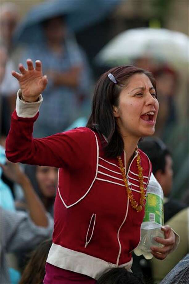 A woman sings during a homage to famed Mexican singer Chavela Vargas at the traditional Mariachi Garibaldi Plaza in Mexico City, Monday, Aug. 6, 2012. Chavela Vargas, who defied gender stereotypes to become one of the most legendary singers in Mexico, died Aug. 5 at age 93. Photo: Eduardo Verdugo, AP / AP