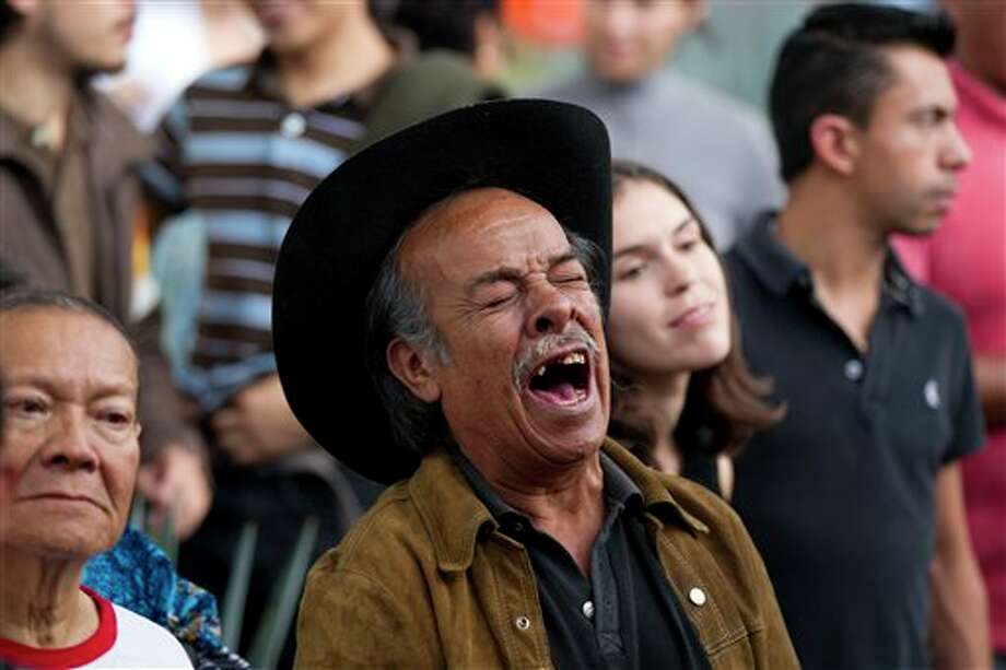 A man sings during a homage to famed Mexican singer Chavela Vargas at the traditional Mariachi Garibaldi Plaza in Mexico City,Monday, Aug. 6, 2012. Chavela Vargas, who defied gender stereotypes to become one of the most legendary singers in Mexico, died Aug. 5 at age 93. Photo: Eduardo Verdugo, AP / AP
