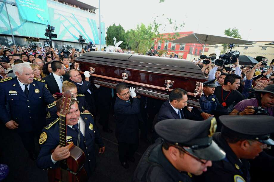 Funeral personnel carry the coffin of the late Costa Rican-born Mexican singer Chavela Vargas during a ceremony in her honour at Garibaldi Square in Mexico City, on August 6, 2012. The iconic singer, who was known for her mastery of the sad and sultry bolero, died on August 5, 2012 at the age of 93. AFP PHOTO/Alfredo Estrella        (Photo credit should read ALFREDO ESTRELLA/AFP/GettyImages) Photo: ALFREDO ESTRELLA, AFP/Getty Images / 2012 AFP