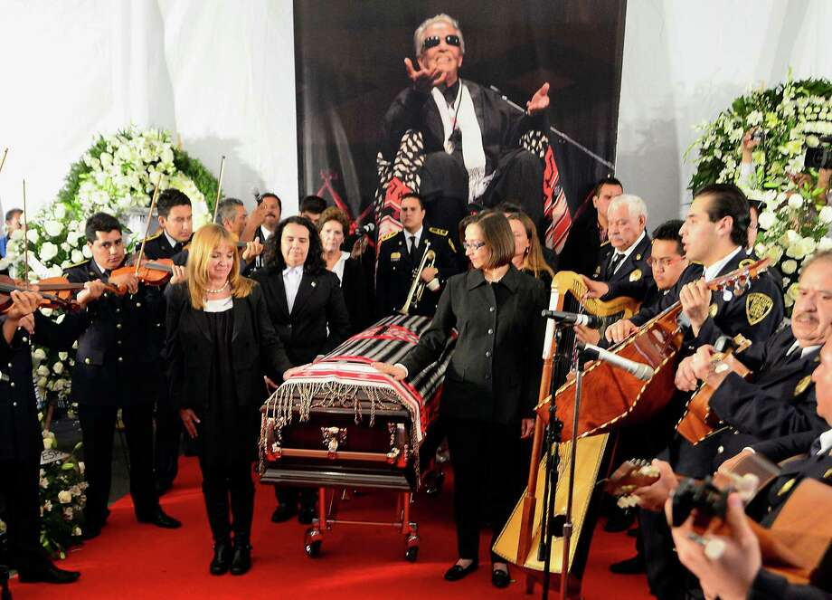 Relatives and musicians stand alongside the coffin of the late Costa Rican-born Mexican singer Chavela Vargas during a ceremony in her honour at Garibaldi Square in Mexico City, on August 6, 2012. The iconic singer, who was known for her mastery of the sad and sultry bolero, died on August 5, 2012 at the age of 93. AFP PHOTO/Alfredo Estrella        (Photo credit should read ALFREDO ESTRELLA/AFP/GettyImages) Photo: ALFREDO ESTRELLA, AFP/Getty Images / 2012 AFP