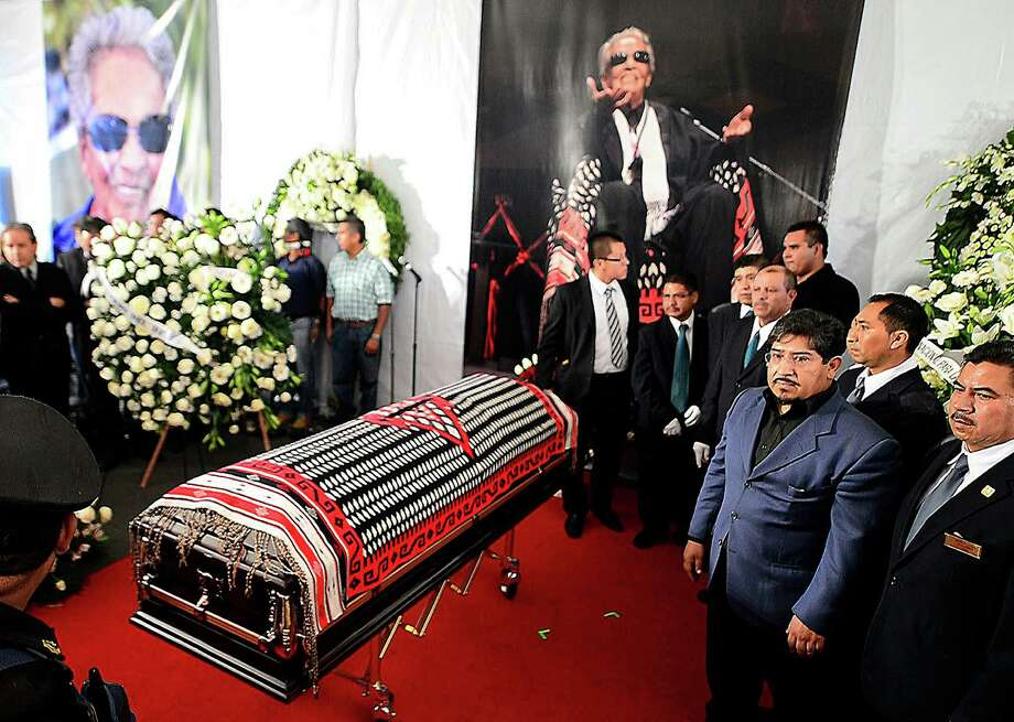 Funeral personnel stand alongside the coffin of the late Costa Rican-born Mexican singer Chavela Vargas during a ceremony in her honour at Garibaldi Square in Mexico City, on August 6, 2012. The iconic singer, who was known for her mastery of the sad and sultry bolero, died on August 5, 2012 at the age of 93. AFP PHOTO/Alfredo Estrella        (Photo credit should read ALFREDO ESTRELLA/AFP/GettyImages) Photo: ALFREDO ESTRELLA, AFP/Getty Images / 2012 AFP