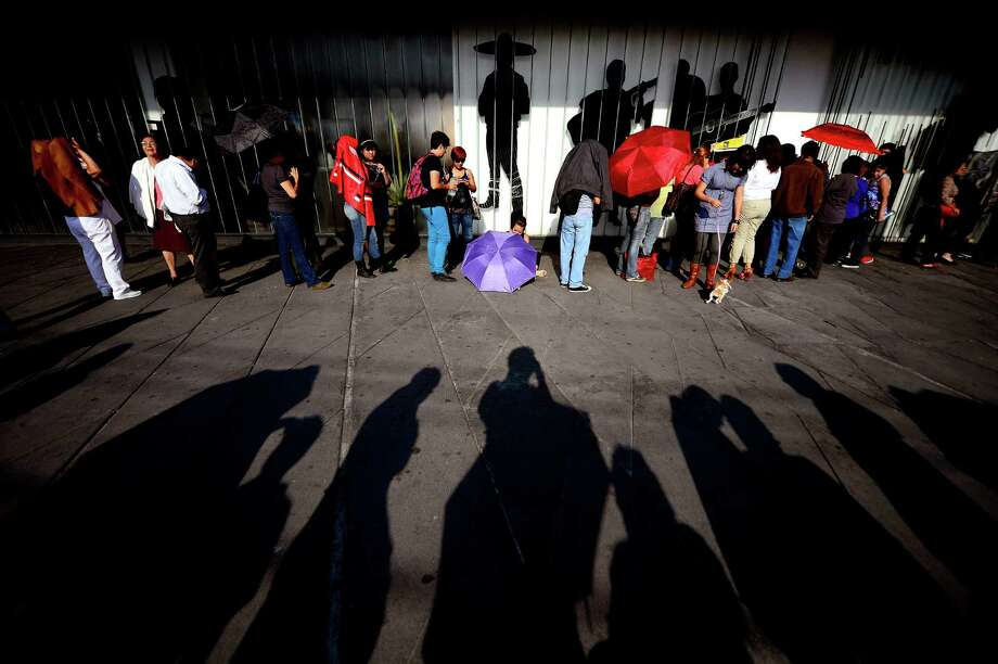 People wait to see the coffin of the late Costa Rican-born Mexican singer Chavela Vargas during a ceremony in her honour at Garibaldi Square in Mexico City, on August 6, 2012. The iconic singer, who was known for her mastery of the sad and sultry bolero, died on August 5, 2012 at the age of 93. AFP PHOTO/Alfredo Estrella        (Photo credit should read ALFREDO ESTRELLA/AFP/GettyImages) Photo: ALFREDO ESTRELLA, AFP/Getty Images / 2012 AFP