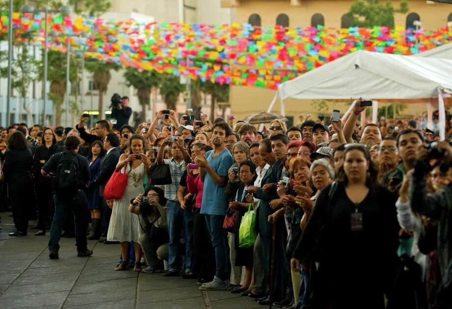 Fans wait to see the coffin of late Costa Rican-born Mexican singer Chavela Vargas during a ceremony in her honour at Garibaldi Square in Mexico City, on August 6, 2012. The iconic singer, who was known for her mastery of the sad and sultry bolero, died on August 5, 2012 at the age of 93. AFP PHOTO/Alfredo Estrella        (Photo credit should read ALFREDO ESTRELLA/AFP/GettyImages) Photo: ALFREDO ESTRELLA, AFP/Getty Images / 2012 AFP