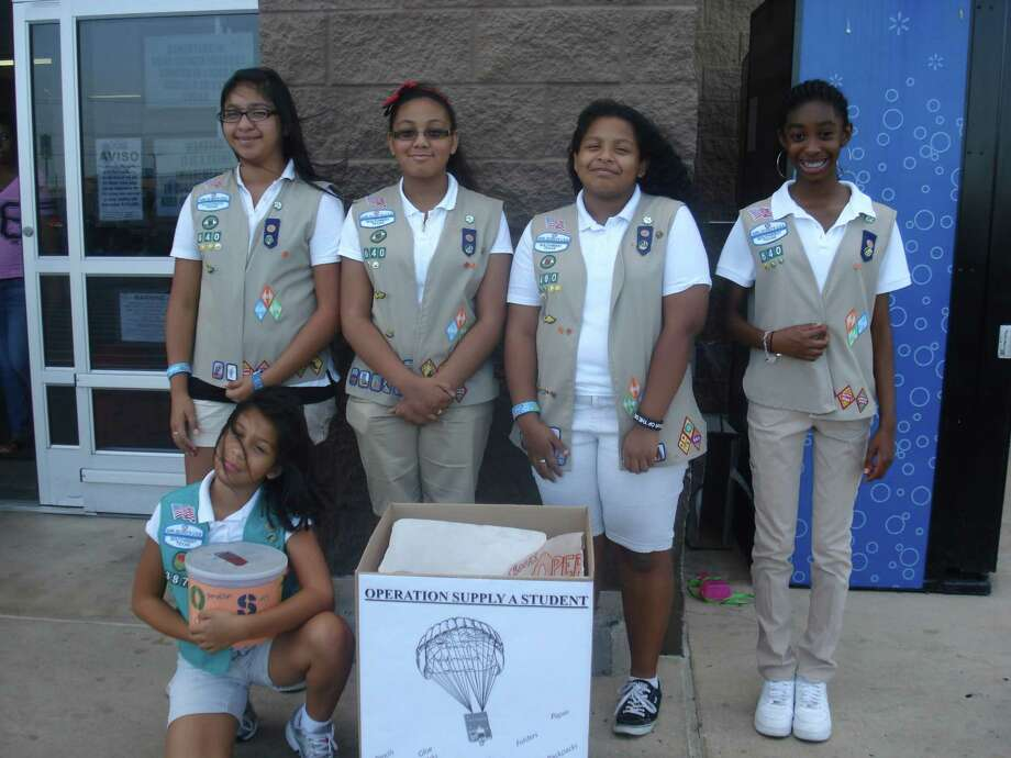 Girl Scouts (top from left) Gabriella Losoya, Gabriella Hernandez, Serena Contreras and Hannah Leake and (front) Analise Contreras gather school supplies during their ÒOperation Supply A StudentÓ drive July 21 at Boost Virgin Mobile on FM 78 in Converse. Not pictured are scouts Cassandrah Mungia and Bernadette Deremiah. Photo: Wanda Thomas Littles, Wanda Thomas Littles / For The N