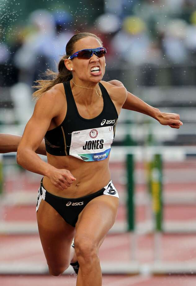 Lolo Jones competes in the women's 100-meter hurdles semi-final at the 2012 U.S. Olympic Track & Field Team Trials at Hayward Field on June 23, 2012, in Eugene, Ore.  (Photo by Michael Heiman/Getty Images) (Michael Heiman / Getty Images)