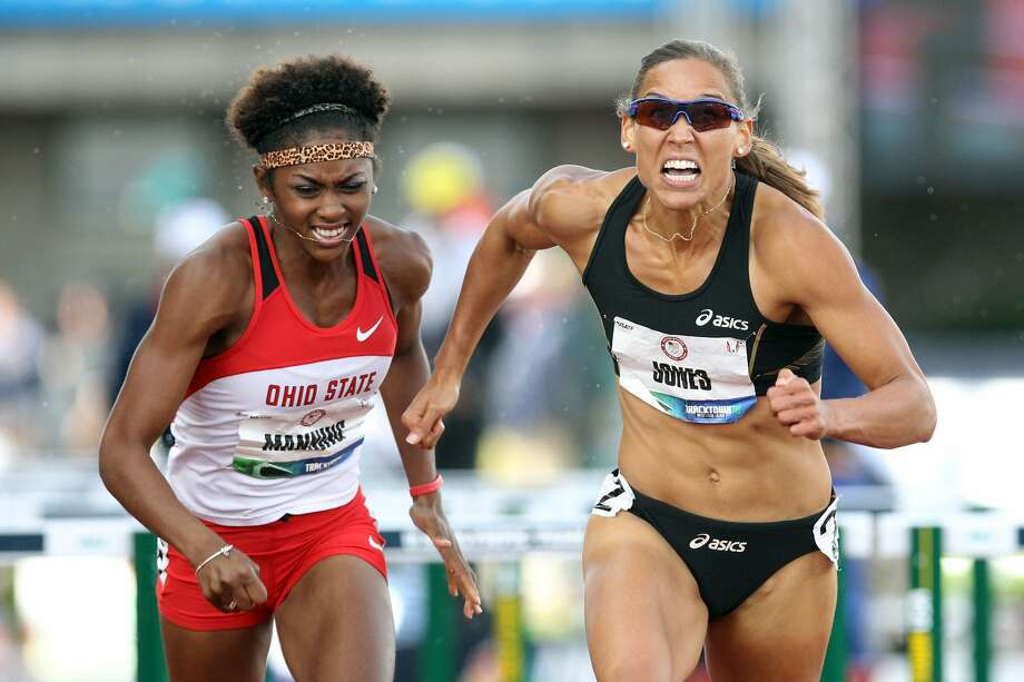 Christina Manning and Lolo Jones compete in the women's 100-meter hurdles at the 2012 U.S. Olympic Track & Field Team Trials at Hayward Field on June 23, 2012, in Eugene, Ore.  (Photo by Christian Petersen/Getty Images) (Christian Petersen / Getty Images)
