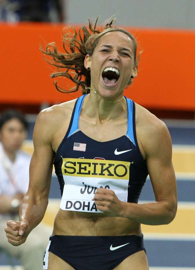 Lolo Jones reacts after winning the women's 60-m hurdles final at the 2010 IAAF World Indoor Athletics Championships at the Aspire Dome in the Qatari capital Doha on March 13, 2010. (VALERY HACHE/AFP/Getty Images) (VALERY HACHE / AFP/Getty Images)