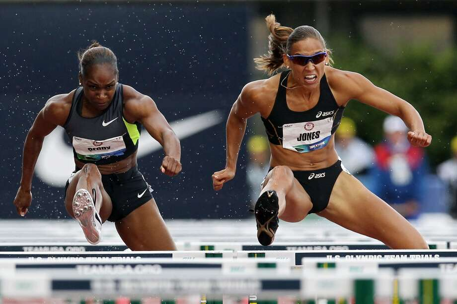 Michelle Perry and Lolo Jones compete in the women's 100-meter hurdles semi-final of the 2012 U.S. Olympic Track & Field Team Trials at Hayward Field on June 23, 2012, in Eugene, Ore.  (Photo by Christian Petersen/Getty Images) (Christian Petersen / Getty Images)